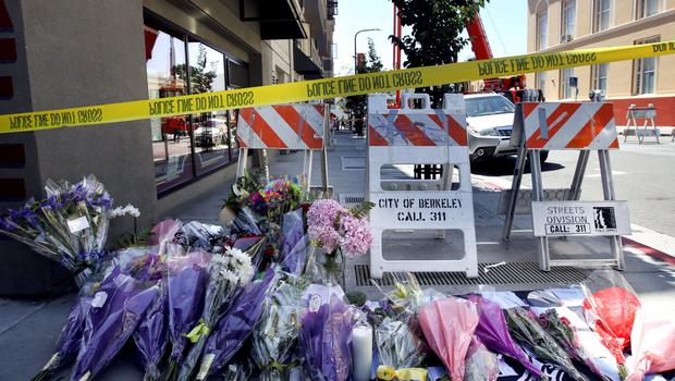 Flowers are laid at a memorial near the scene of a 4th-story apartment building balcony collapse in Berkeley, California June 16, 2015. REUTERS/Elijah Nouvelage