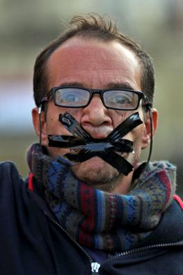 A protester tapes his mouth closed during a demonstration after a judge on Saturday dismissed the case against former President Hosni Mubarak and acquitted his security chief over the killing of protesters during Egypts 2011 uprising, near Tahrir Square. AP Photo/Hussein Tallal