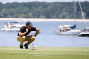 Rory McIlroy lines up a putt on the 18th green during the third round of the RBC Heritage golf tournament at Harbour Town Golf Links,  Hilton Head, South Carolina. Photo: Brian Spurlock-USA TODAY Sports