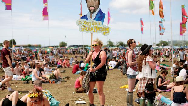 A festival goer carrying a Lionel Richie placard at the Glastonbury Festival, at Worthy Farm in Somerset. PRESS ASSOCIATION Photo. Picture date: Saturday June 27, 2015. Photo credit should read: Yui Mok/PA Wire