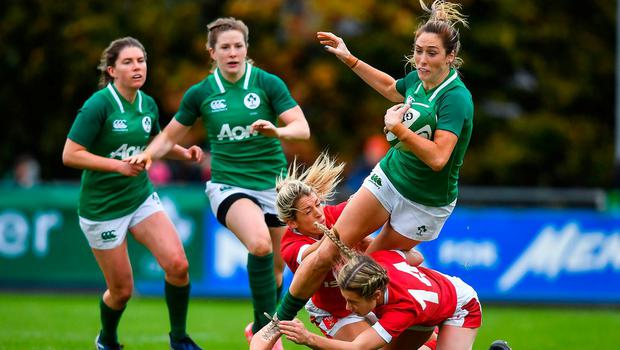 Ireland's Eimear Considine is tackled by Welsh duo Alecs Donovan (left) and Paige Randall during their 2019 international at the UCD Bowl. Photo: David Fitzgerald/Sportsfile