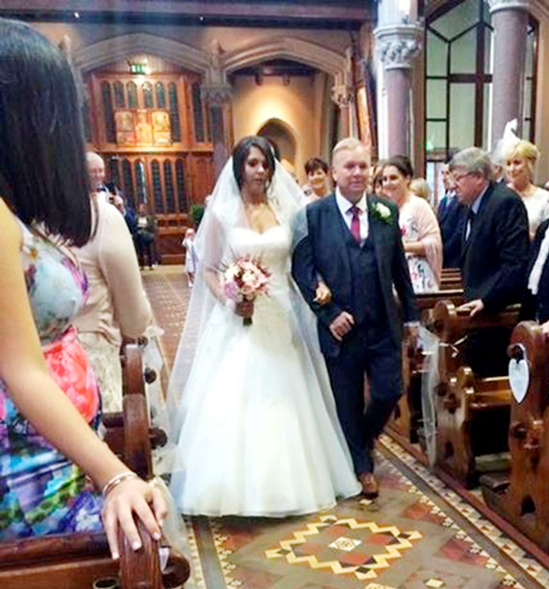 John Taaffe escorts daughter Amy up the aisle in St Mary's Church, Drogheda Picture: Martyn Smyth