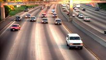 OJ Simpson in a white Ford Bronco is followed by LA police in June 1994. Photo: Joseph Villarin/AP Photo