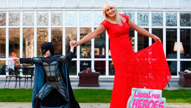 RTÉ presenter Miriam O'Callaghan at the launch of the LauraLynn Heroes Ball – helped by superhero Josh McCabe (8), from Stillorgan, Dublin. Photo: Conor McCabe Photography