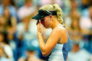 Caroline Wozniacki reacts during her defeat to Petra Cetkovska. Photo by Clive Brunskill/Getty Images