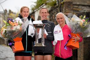 1 June 2015; Winner Maria McCambridge, centre, Dundrum South Dublin A.C., with third place Catherina McKiernan, left, Analee AC, Co. Cavan, and second place Anne Marie McGlynn, Letterkenny A.C, Co. Donegal, after the Vhi Womens Mini Marathon. Merrion Square, Dublin. Picture credit: Brendan Moran / SPORTSFILE