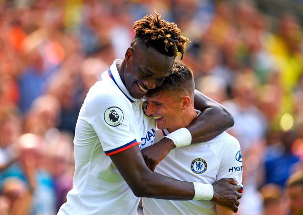 Tammy Abraham celebrates with teammate Mason Mount after he scores Chelsea's second at Carrow Road at the weekend. Photo: PA