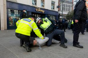 MAXIMUM DISRUPTION: Gardai restrain a man during last               weekend's anti-lockdown protest in Dublin.               Photo: Damian Eagers/PA