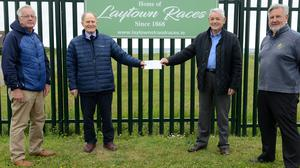 Joe Collins, centre, Chairperson  Laytown Races Committee, and Paul Kerbey,  far left, Laytown Races Committe presenting a cheque to PJ Geraghty president of the Star of the Sea St Vincents de Paul  and Vice President Jim Griffin,  far right. Pic Jimmy Weldon.