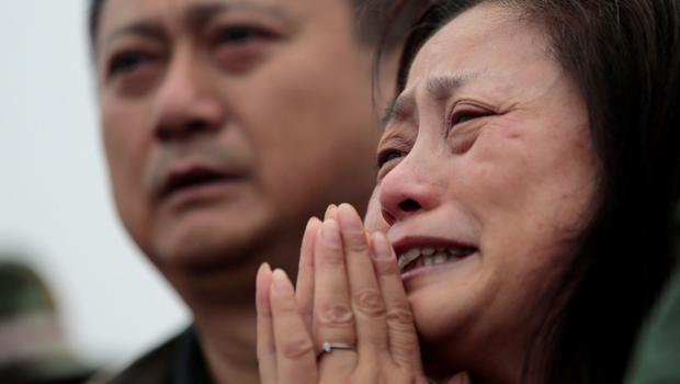 A relative of a missing passenger aboard the capsized ship Eastern Star cries on the banks of the Jianli section of Yangtze River in Hubei province, China, June 4, 2015. REUTERS/Aly Song