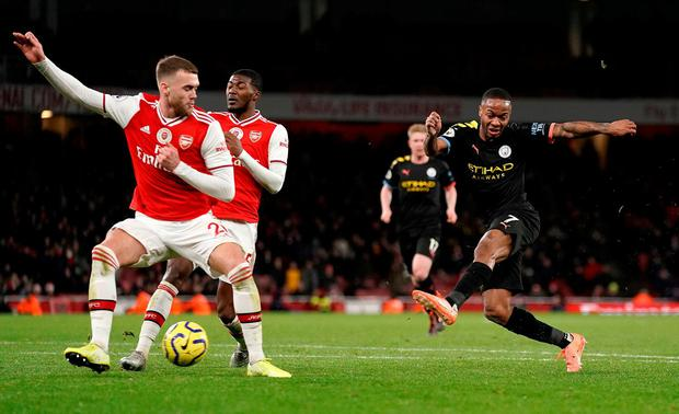 Manchester City's Raheem Sterling (right) has a shot on goal. Photo: John Walton/PA Wire