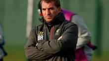 Liverpool's manager Brendan Rodgers watches his players during a training session at the club's Melwood training complex in Liverpool. Reuters