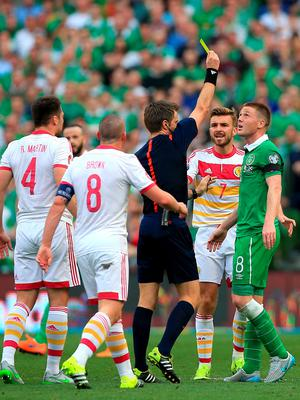 Republic of Ireland's James McCarthy is shown a yellow card for a challenge on Scotland's Russell Martin during the UEFA European Championship Qualifying match at the Aviva Stadium, Dublin.  Nick Potts/PA Wire