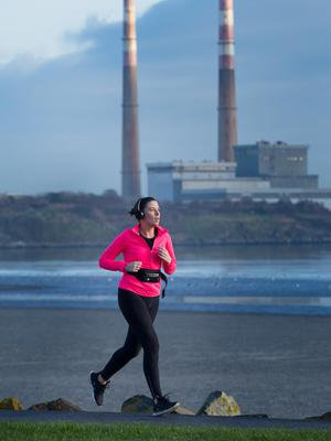High winds on the way: A runner enjoys the crisp morning in Dublin yesterday ahead of the arrival of Storm Ciara this weekend. Photo: Owen Breslin