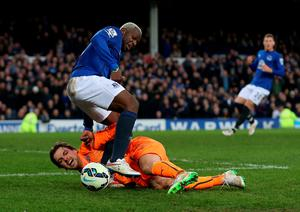 Tim Krul of Newcastle United challenges Arouna Kone of Everton