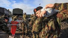 All hands to the pump: Members of the 6th Infantry Battalion and the 2nd Artillery Regiment get sandbags. Photos: Mark Condren