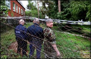 Gardai and members of the army at the scene at the grounds of Moyle Park College in Clondalkin where a door fell off an army helicopter. Photo by Steve Humphreys, 21st May 2020