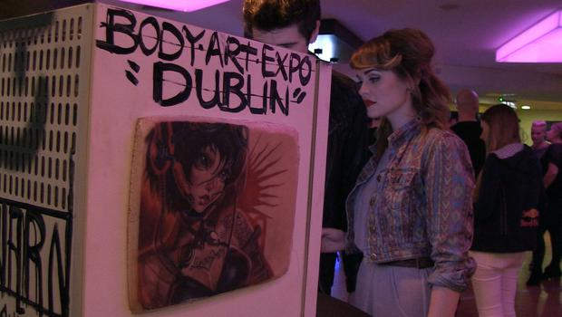 Guests take a look at the Red Bull Canvas Coolers at the Generator Hostel in Smithfield, Dublin.