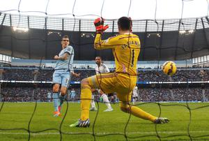 Stevan Jovetic (L) shoots to score City's first goal against Swansea. Photo credit: REUTERS/Phil Noble