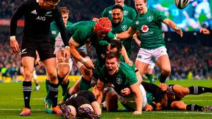 Jacob Stockdale of Ireland celebrates after scoring his side's first try during the Guinness Series International match between Ireland and New Zealand at the Aviva Stadium in Dublin. Photo by Ramsey Cardy/Sportsfile