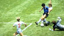 Diego Maradona scores for Argentina in  the 1986 FIFA World Cup quarter-final win over England at the Azteca Stadium, Mexico City. Photo: Reuters/Juha Tamminen/File Photo