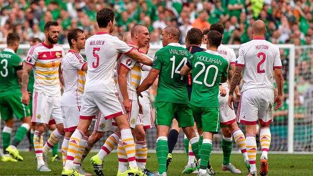 Ireland's Jonathan Walters and Scotland captain Scott Brown confront each other. Photo: David Maher / SPORTSFILE