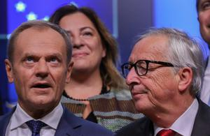 Tense: President of the European Council Donald Tusk and European Commission President Jean-Claude Juncker at the start of the EU Tripartite Social Summit in Brussels. Picture: Reuters