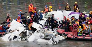 Rescuers pull passengers from the aircraft