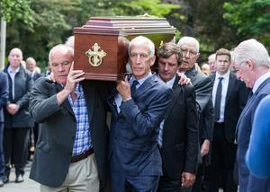 Teammates: From left, Fran Ryder, Bobby Doyle, Kevin Moran and Paddy Cullen shoulder the remains of Anton O'Toole for his funeral Mass. Photo: Mark Condren