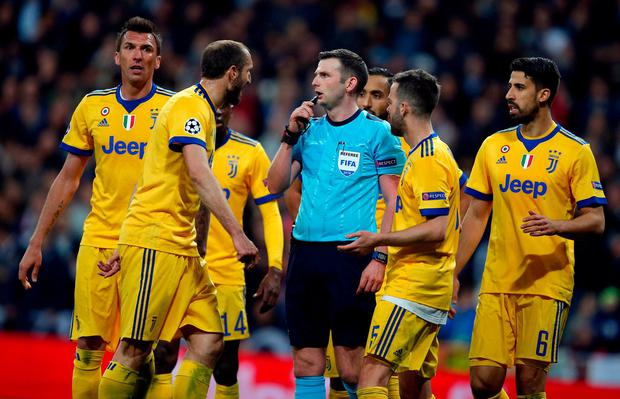 Juventus players complain to Referee Michael Oliver. Photo: Paul White/AP Photo