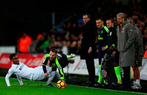 Swansea City's Leroy Fer (left) and Arsenal's Aaron Ramsey in action. Photo credit: Nick Potts/PA Wire