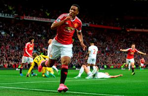 Anthony Martial celebrates after scoring on his debut for Manchester United