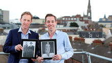 Barry Andrews (left) with a picture of his grandfather Todd Andrews and Eamon de Valera, while Ryan Tubridy holds a picture of Todd Andrews.