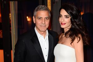 George Clooney and Amal Clooney attend the Cesar Dinner at Le Fouquet's on February 24, 2017 in Paris, France.  (Photo by Stephane Cardinale - Corbis/Getty Images)