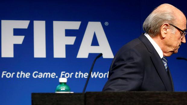 FIFA president Sepp Blatter leaves the stage after announcing his plans to stand down in Zurich yesterday