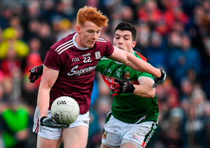 Peter Cooke of Galway in action against Brian Reape of Mayo. Photo by Harry Murphy/Sportsfile