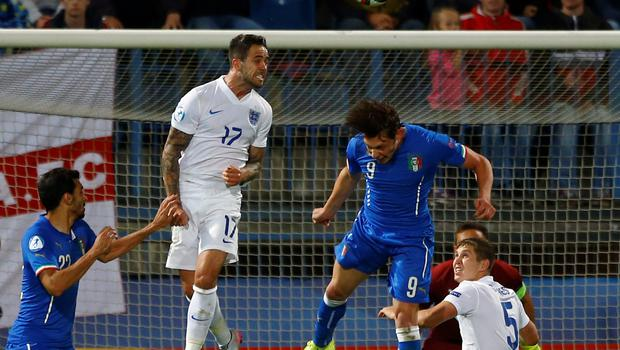 England's Danny Ings gets to the ball ahead of Andrea Belotti