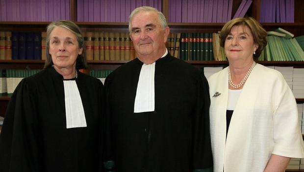 26/6/2015 L-R: Chief Justice of the Supreme Court of Ireland, Ms Justice Susan Denham, Mr Justice John Murray and his wife, Gabrielle pictured at the Four Courts yesterday(Fri) following his final day on the bench of the Supreme Court.Pic: Courts Collins