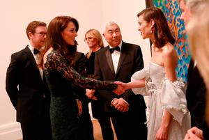 The Duchess of Cambridge greets model Alexa Chung at the National Portrait Gallery in London for the 2017 Portrait Gala