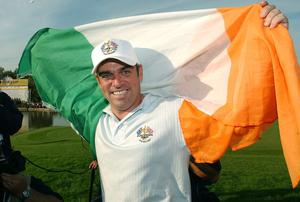 Paul McGinley flies the flag for Ireland as he celebrates Ryder Cup victory at the Belfry in 2002. Photo: Ross Kinnaird/Getty Images