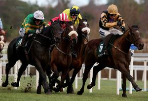 Plinth ridden by Tony McCoy (left) races to the finish on the way to winning the Paddy Power at the 2013 Leopardstown Christmas Festival