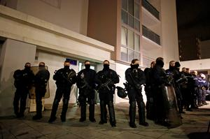 Police officers secure access to a residential building during investigations in the eastern French city of Reims January 8, 2015, after the shooting against the Paris offices of Charlie Hebdo, a satirical newspaper. REUTERS/Jacky Naegelen