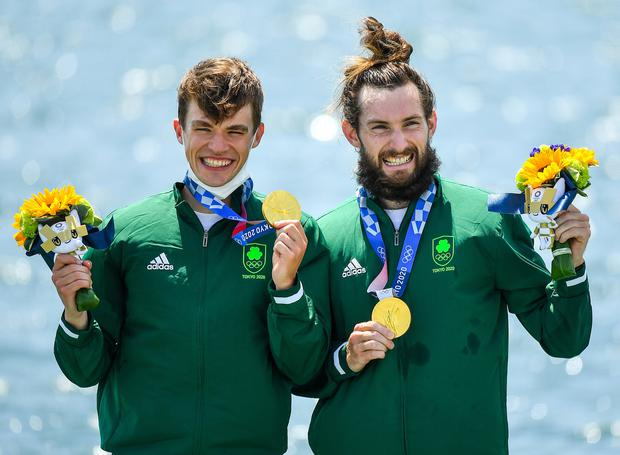 Fintan McCarthy, left, and Paul O'Donovan celebrate with their Olympic gold medals. Photo by Seb Daly/Sportsfile