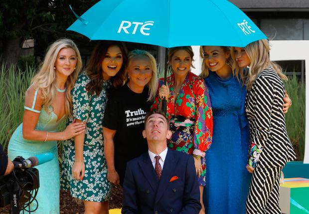 16/8/2018 Things are looking up for Tubridy - RTE announce New Season Launch - Ryan Tubridy joins other RTE stars under an umbrella as rain interrupted a photocall at Donnybrook in Dublin yesterday(Thurs) - L-R: Jenny Dixon, Doireann Garrihy, Dr Eva Orsmond, Amy Huberman, Anna Geary and Laura Whitmore.Pic: Collins
