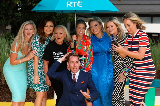 16/8/2018 RTE announce New Season Launch - RTE stars under an umbrella pose for the media after rain interrupted a photocall at Donnybrook in Dublin yesterday(Thurs) - L-R: Jenny Dixon, Doireann Garrihy, Dr Eva Orsmond, Ryan Tubridy, Amy Huberman, Anna Geary, Laura Whitmore and Kathryn Thomas.Pic: Collins