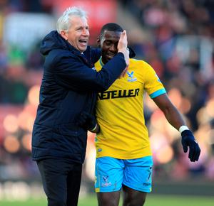 Crystal Palace manager Alan Pardew celebrates at the final whistle with Yannick Bolasie during the Barclays Premier League match at the Britannia Stadium, Stoke-on-Trent. PRESS ASSOCIATION Photo. Picture date: Saturday March 21, 2015. See PA story SOCCER Stoke. Photo credit should read: Mike Egerton/PA Wire. RESTRICTIONS: Editorial use only. Maximum 45 images during a match. No video emulation or promotion as 'live'. No use in games, competitions, merchandise, betting or single club/player services. No use with unofficial audio, video, data, fixtures or club/league logos.