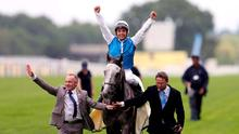 Jockey Maxime Guyon celebrates winning the Queen Anne Stakes on Solow during day one of the 2015 Royal Ascot Meeting