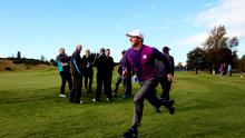 Rory McIlroy runs and smiles on the course ahead of the 2014 Ryder Cup on the PGA Centenary course at the Gleneagles Hotel