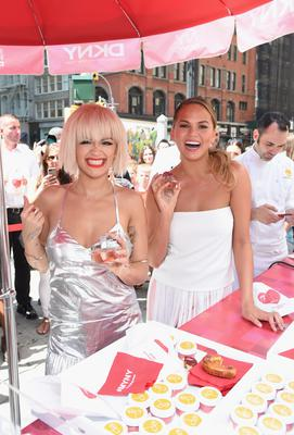 Actress, singer Rita Ora and model Chrissy Teigen attend as DKNY celebrates the launch of the new DKNY MYNY fragrance with Rita Ora, Chrissy Teigen, Hannah Bronfman, among other notables, at General Worth Square at Madison Square Park on August 19, 2014 in New York City.  (Photo by Jamie McCarthy/Getty Images for DKNY)
