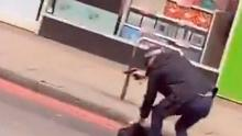 Screengrab from video taken with permission from the Twitter feed of @gullyyt of an armed police officer on Streatham High Road.d: Gully/PA Wire